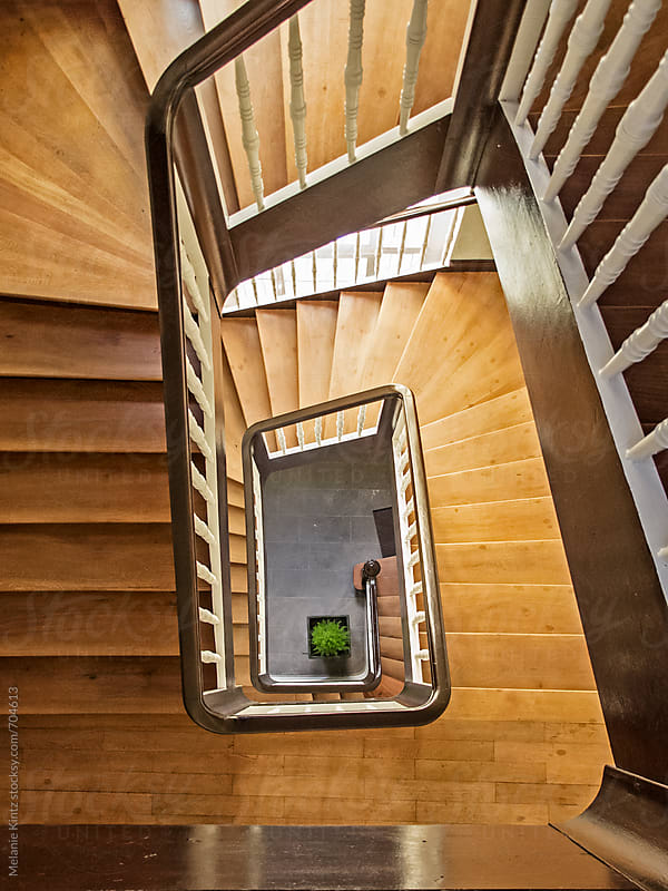 staircase of a house, looking down by Melanie Kintz for Stocksy United
