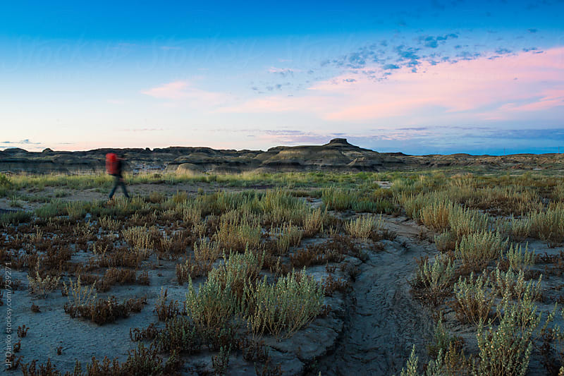 Man Hiking In Bisti Badlands Bisti/De-Na-Zin Wilderness New Mexico USA by JP Danko for Stocksy United