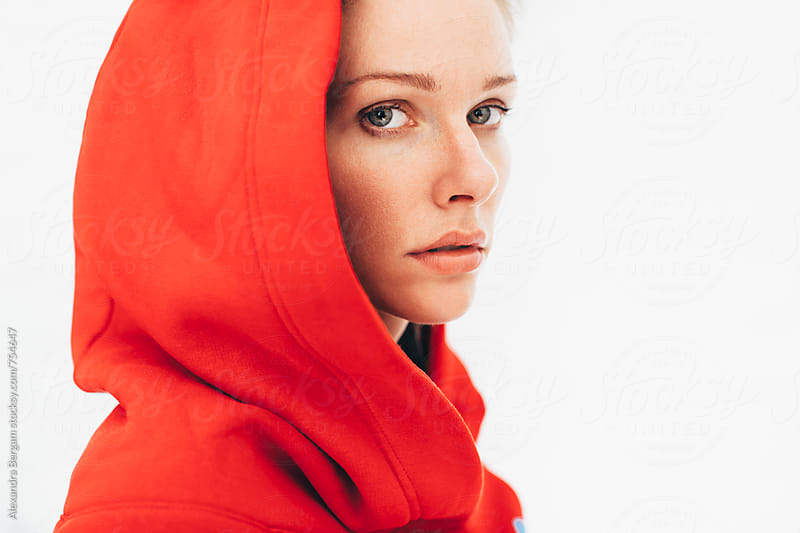Portrait of a woman wearing red hoodie by Aleksandra Kovac for Stocksy United