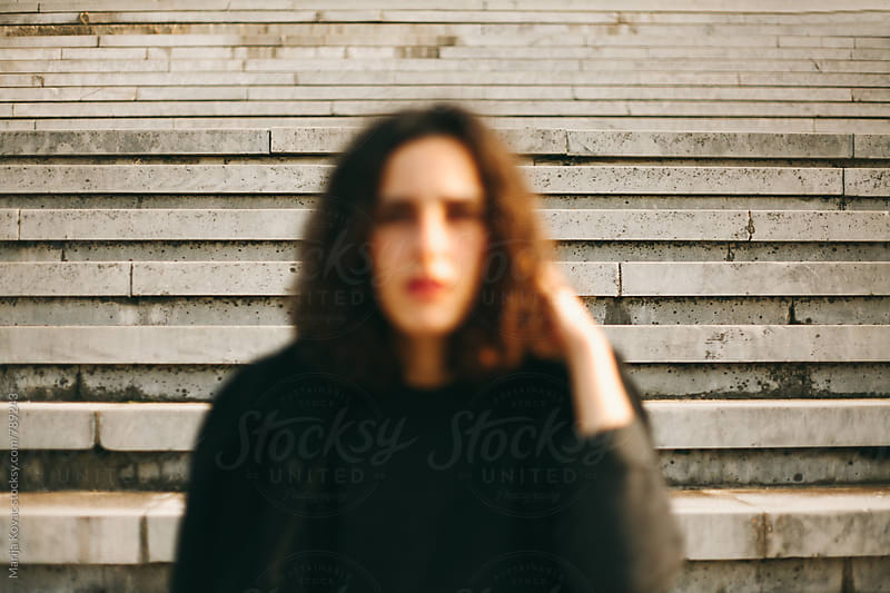 Blurry portrait of a young woman by Marija Kovac for Stocksy United