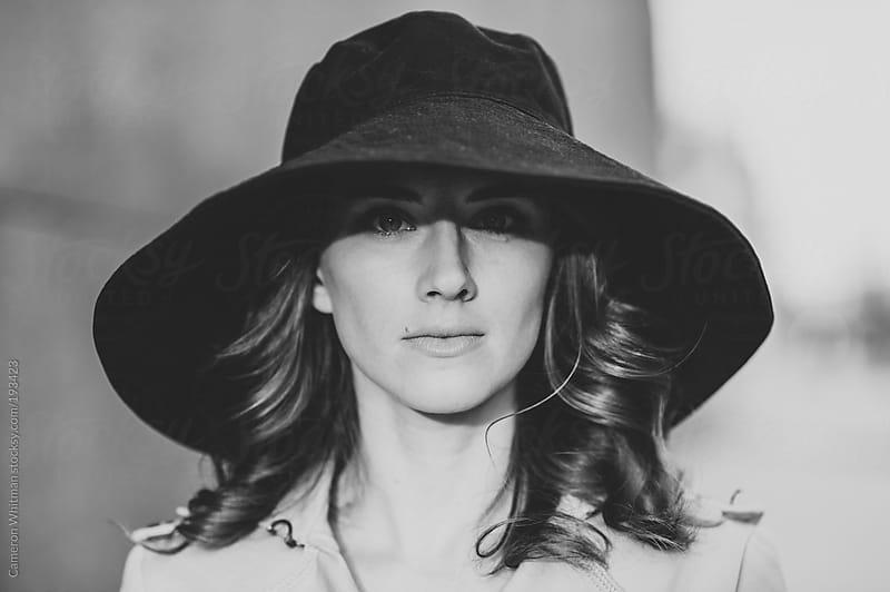 Pretty girl big black hat portrait by Cameron Whitman for Stocksy United