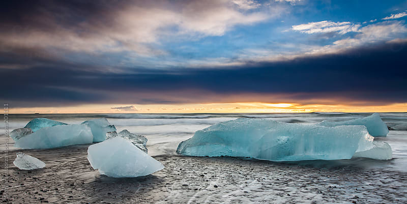 Sunrise on the beach at Jokulsarlon by Marilar Irastorza for Stocksy United