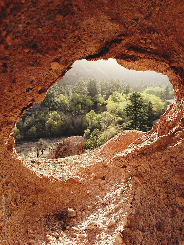 Tree Valley Through Rock Hole by Kevin Russ for Stocksy United