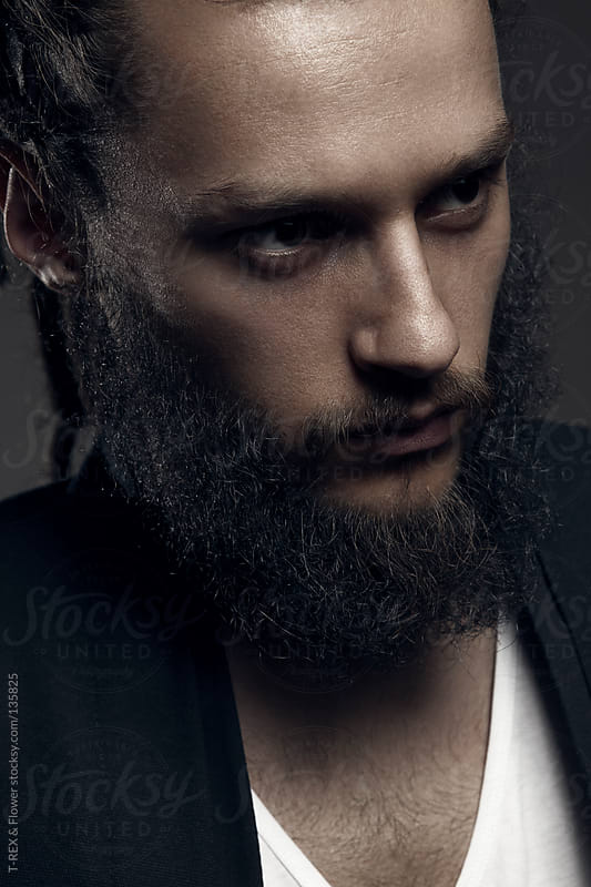 An image of a handsome man with a beard by T-REX & Flower for Stocksy United