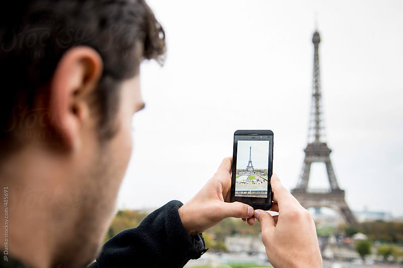 Man Taking Mobile Phone Photo of Eiffel Tower Paris from The The Trocadéro by JP Danko for Stocksy United