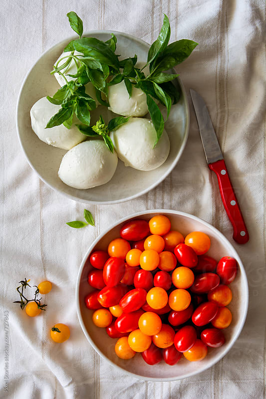 Cherry tomato mozzarella salad by Pixel Stories for Stocksy United