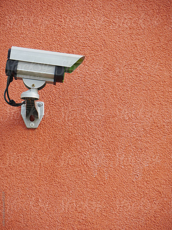security camera safety wall orange by rolfo for Stocksy United