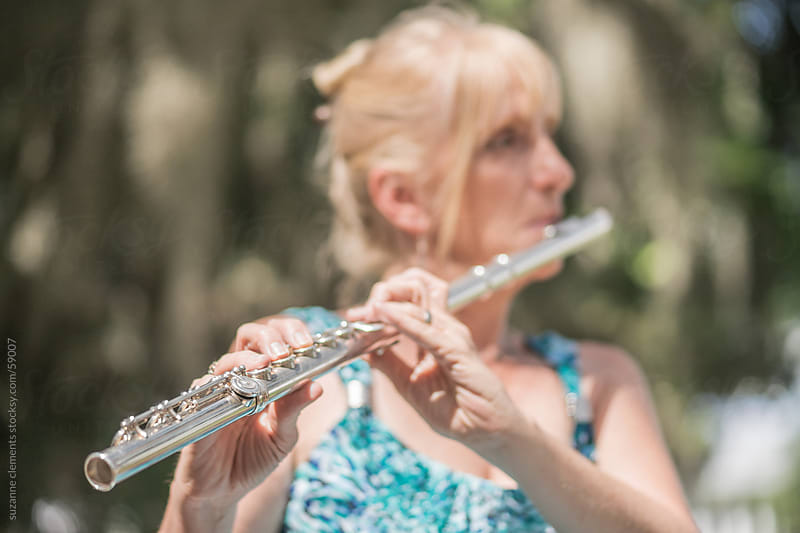 Successful Simphony Musician Plays Her Flute by suzanne clements for Stocksy United