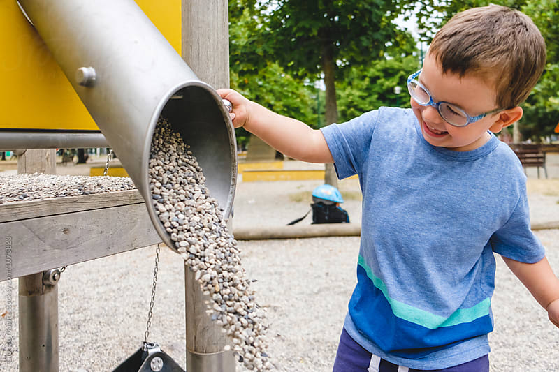 Male Toddler Playing with Gravel at the Playground by Giorgio Magini for Stocksy United