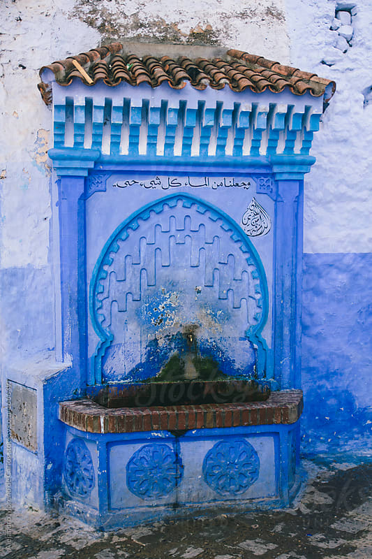 Blue arab fountain in Chefchaouen, Morocco. by Alejandro Moreno de Carlos for Stocksy United