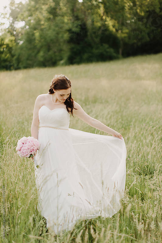Bride in Field by Sidney Morgan for Stocksy United