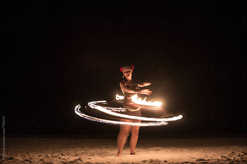 Woman Spinning With the Fire by Mosuno for Stocksy United
