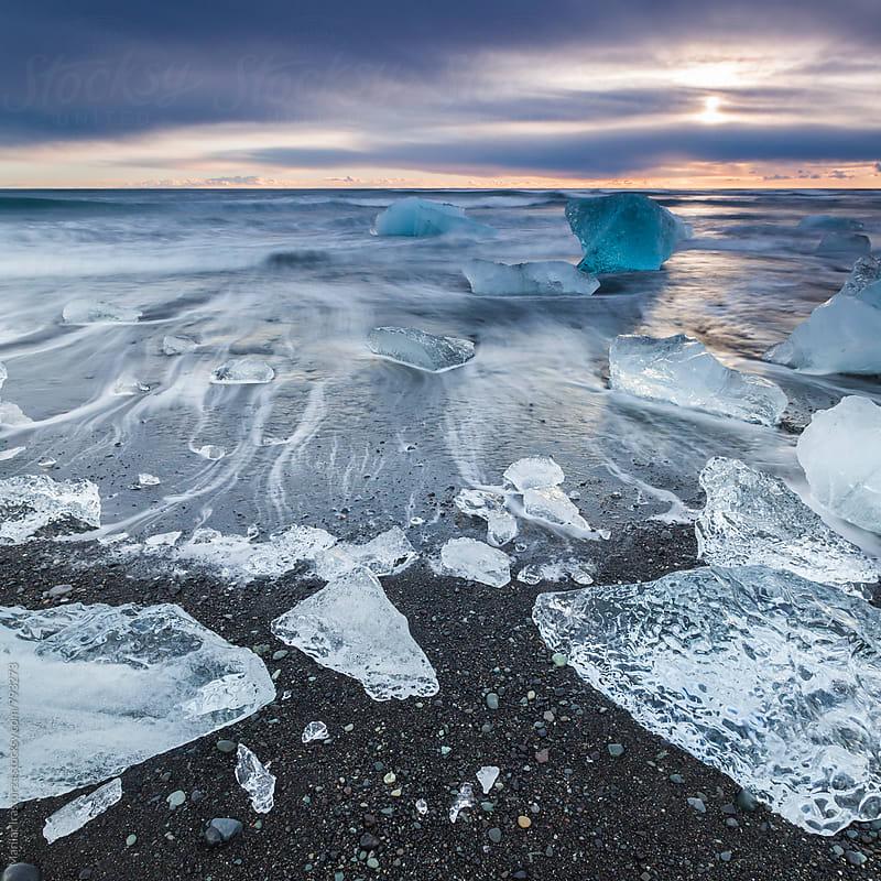 Icebergs at Jokulsarlon black sand beach by Marilar Irastorza for Stocksy United