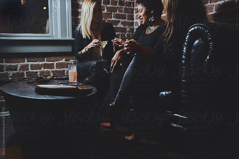 Ladies talking in a lounge by Alicja Colon for Stocksy United