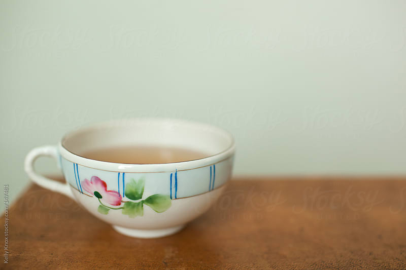 tea in a vintage teacup by Kelly Knox for Stocksy United