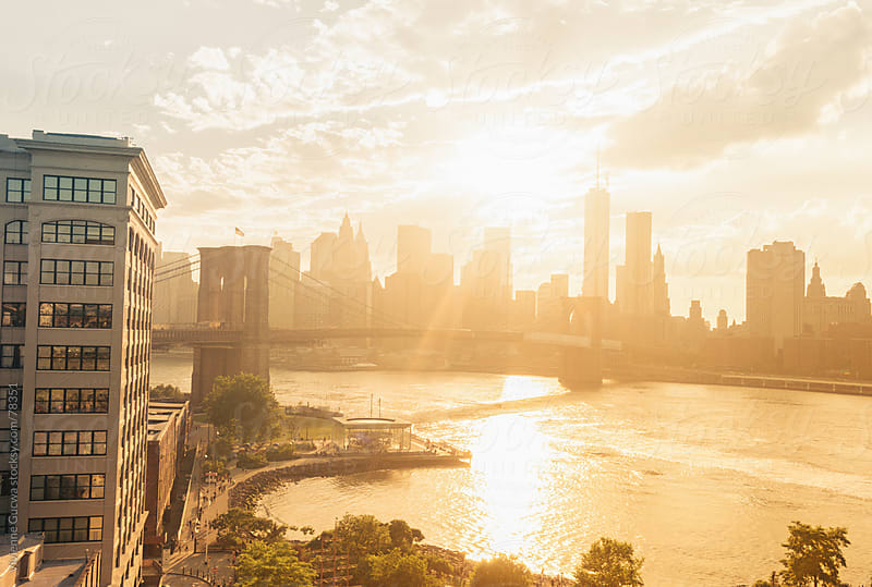 Sunset over the Brooklyn Bridge and New York City Skyline by Vivienne Gucwa for Stocksy United