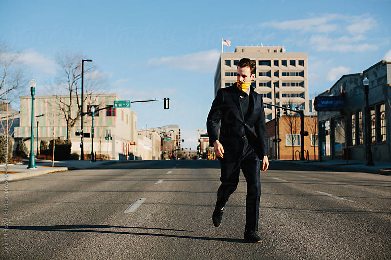 Walking down the middle of Main street. by Dylan M Howell Photography for Stocksy United