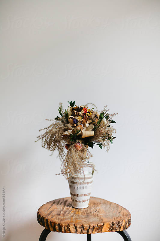 Flowers in a white vase  by Marija Kovac for Stocksy United