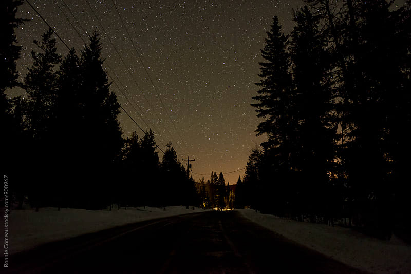 Late Night Winter Road by Ronnie Comeau for Stocksy United