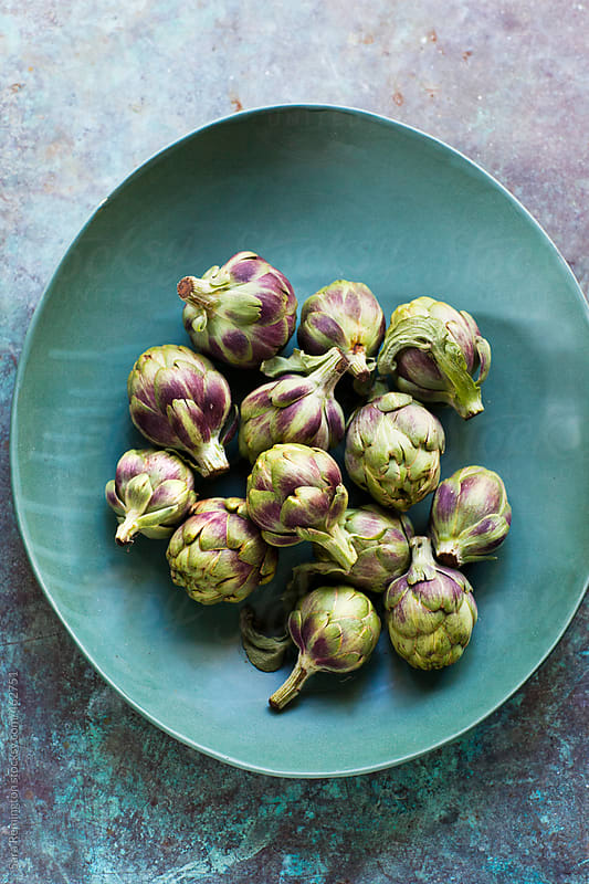 Baby Artichokes In Blue Bowl by Sara Remington for Stocksy United
