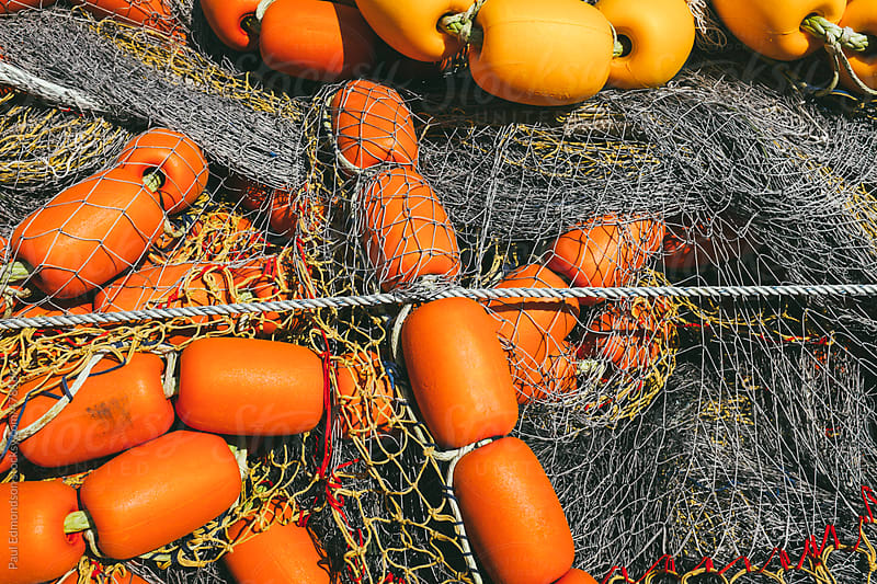 Pile of floats and commercial fishing nets by Paul Edmondson for Stocksy United