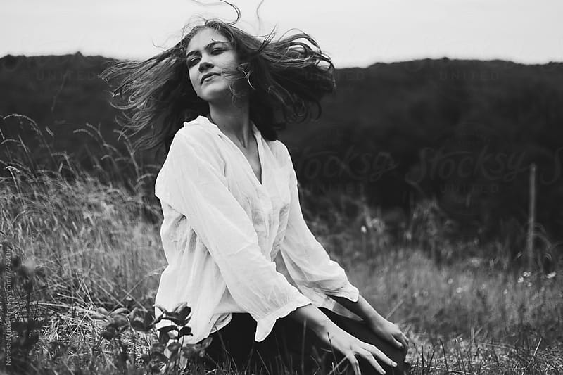 Beautiful girl with her hair flying around by Natasa Kukic for Stocksy United