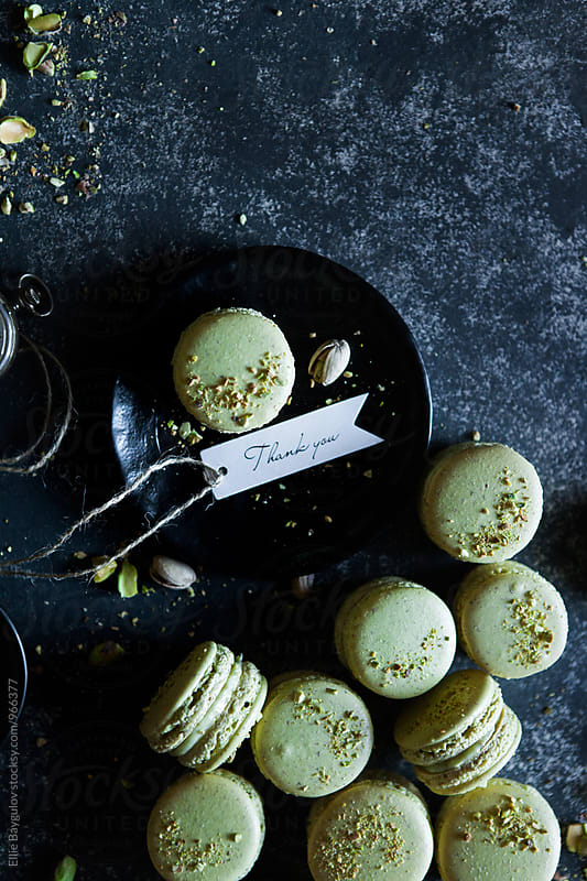 Pistachio macarons by Ellie Baygulov for Stocksy United
