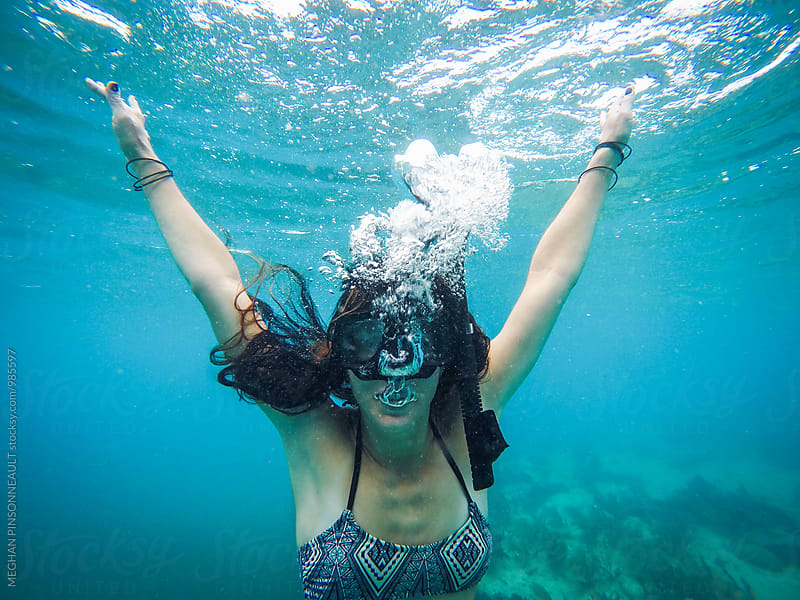 Woman Underwater in Snorkel Mask with Bubbles by Meg Pinsonneault for Stocksy United