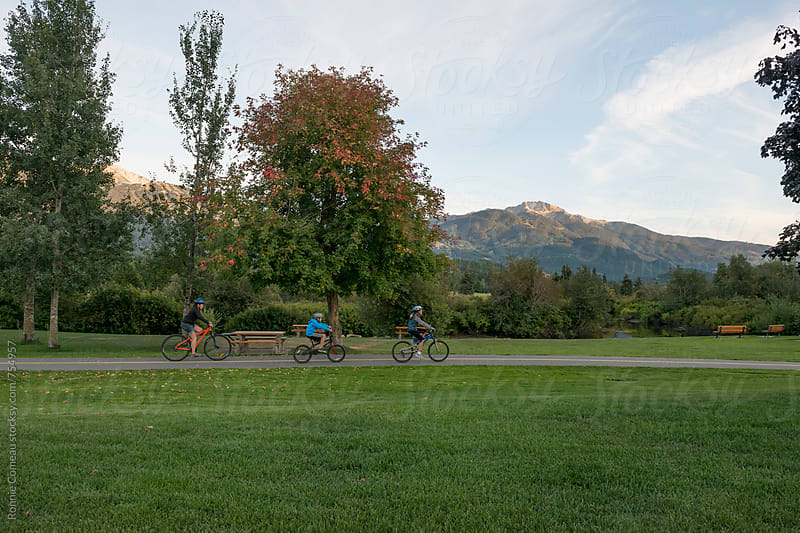 Family Bike Ride by Ronnie Comeau for Stocksy United