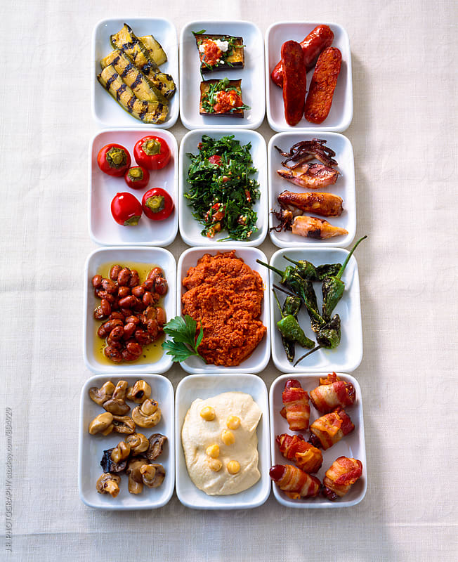 Variety of antipasti, tapas in bowls by J.R. PHOTOGRAPHY for Stocksy United