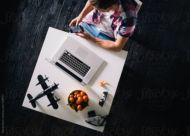 Working Desk of a Young Designer from Above by Marija Savic for Stocksy United