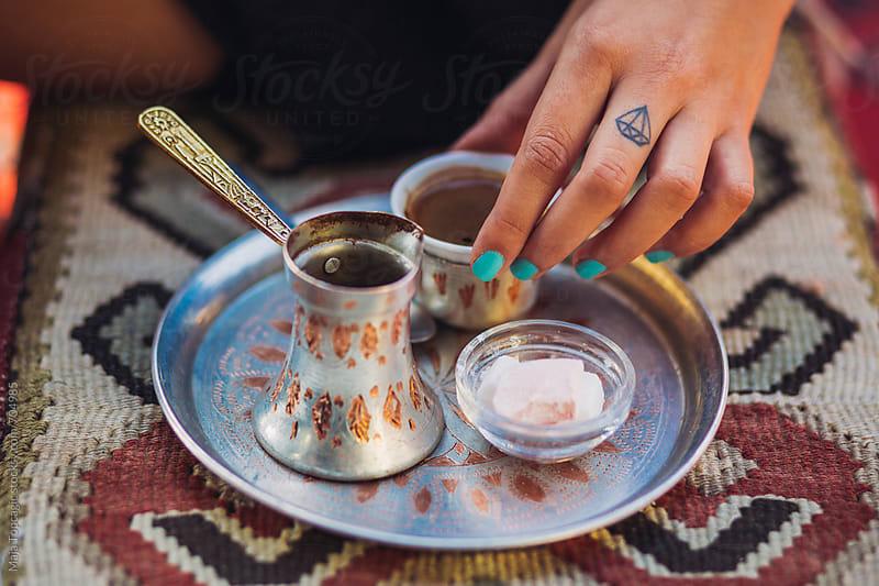 Woman drinking bosnian traditional coffee by Maja Topcagic for Stocksy United