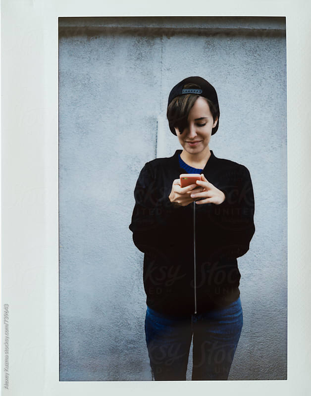instant photo with young woman on the phone by Alexey Kuzma for Stocksy United