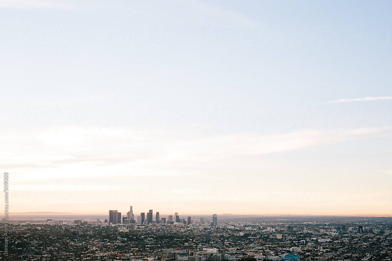 Los Angeles Skyline at Sunrise by Simone Anne for Stocksy United