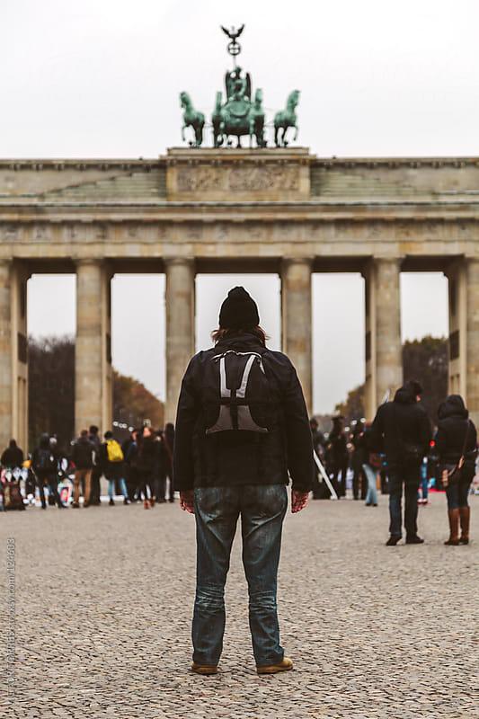Man Staring at Brandenburg Gate by VICTOR TORRES for Stocksy United
