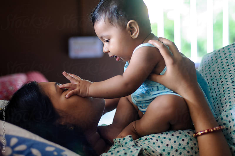 Baby girl playing with her mother by Saptak Ganguly for Stocksy United