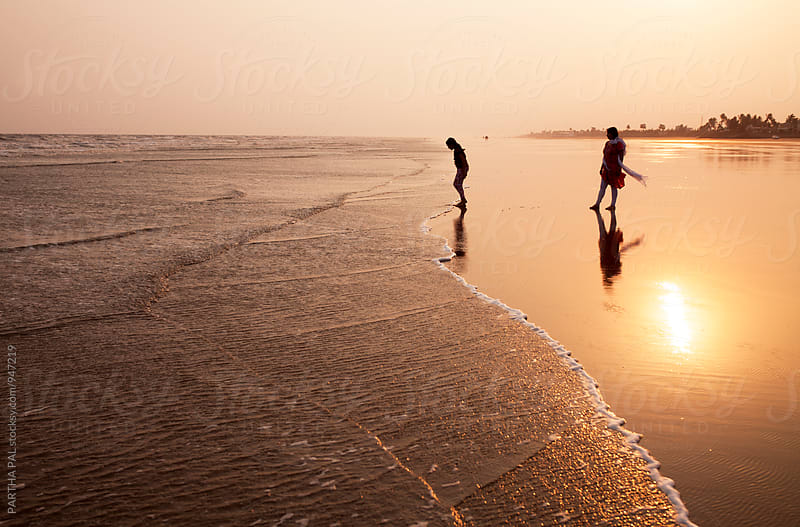 Mother and daughter make enjoyment in the beach  by PARTHA PAL for Stocksy United