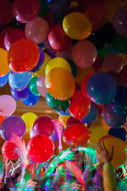 Balloons fall from the ceiling at New Year\'s Eve party.