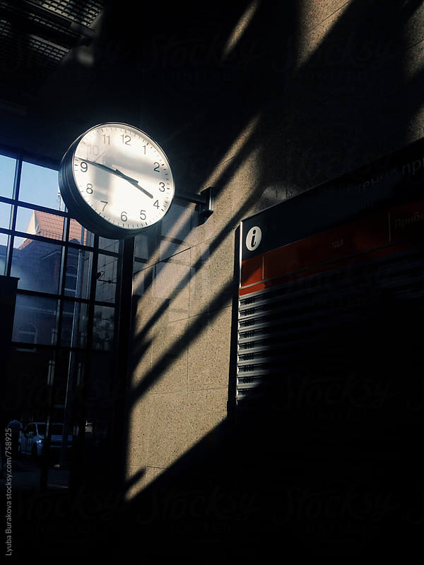 Clock at railway station in contrast light by Lyuba Burakova for Stocksy United