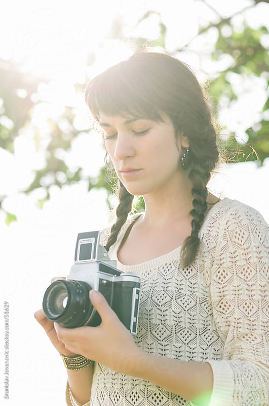 Beautiful Woman With Braids Holding Retro Camera by Brkati Krokodil for Stocksy United