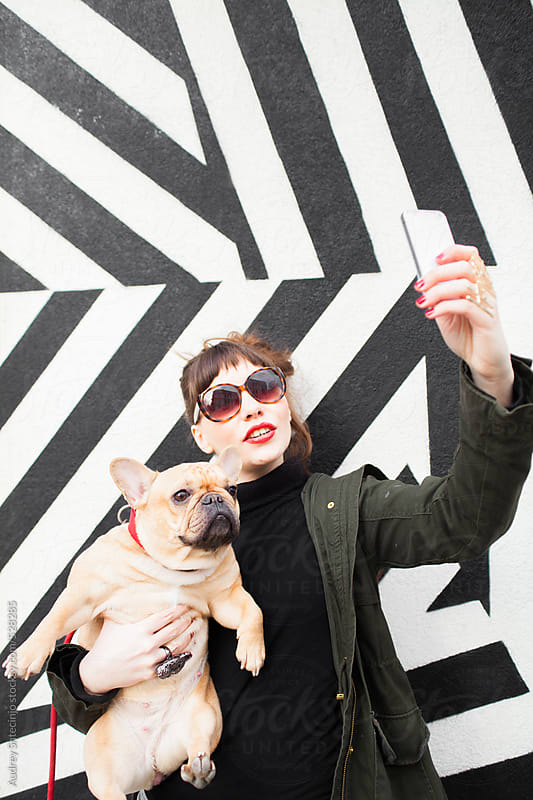 Handsome hip female taking selfie with her pet. by Audrey Shtecinjo for Stocksy United