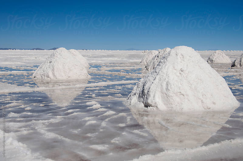 Close up of salt piles in the salt flats. by Mike Marlowe for Stocksy United