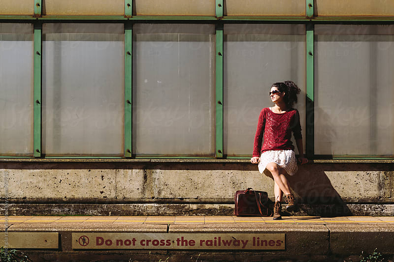 Young woman waiting for the train by michela ravasio for Stocksy United