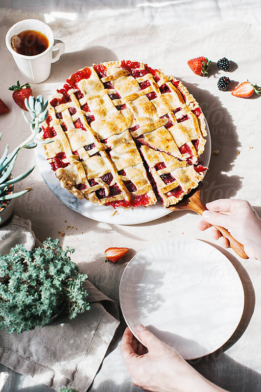 Berry pie by Ellie Baygulov for Stocksy United