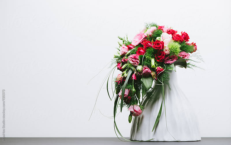 Fresh flowers in a vase by MaaHoo Studio for Stocksy United