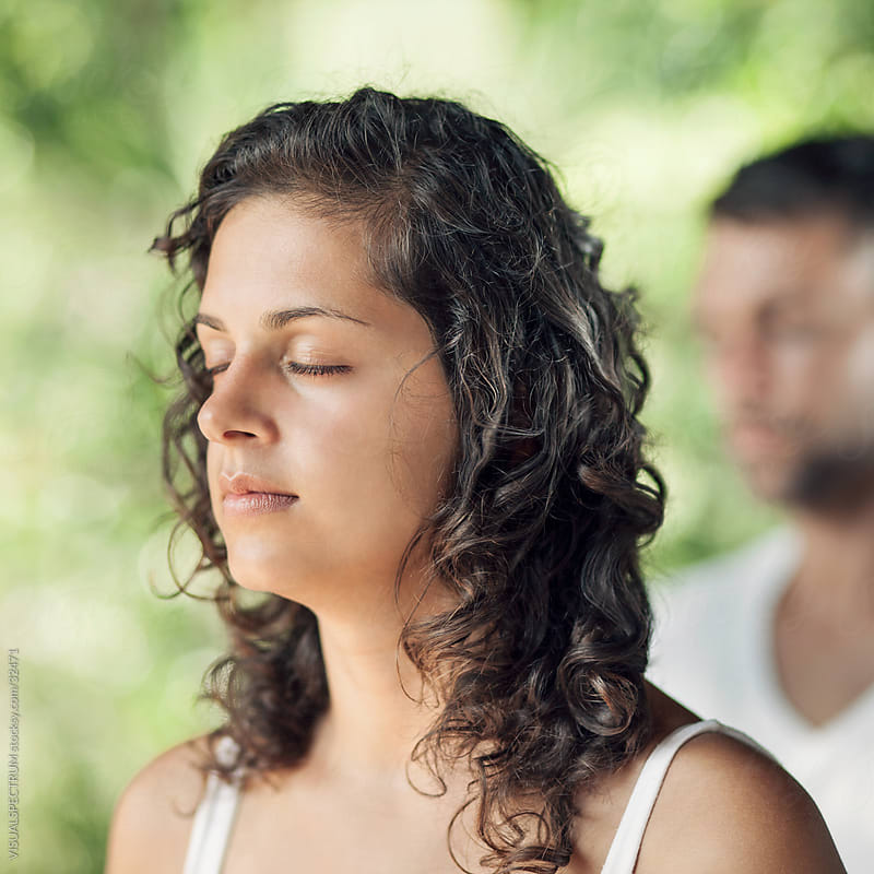 Young Meditating Woman With Eyes Closed by VISUALSPECTRUM for Stocksy United