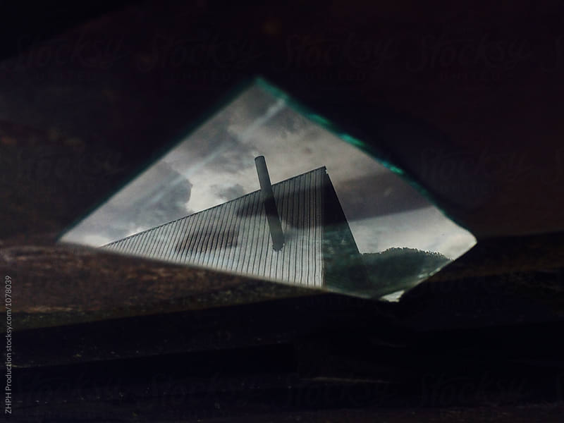 House reflected in a broken glass by Artem Zhushman for Stocksy United