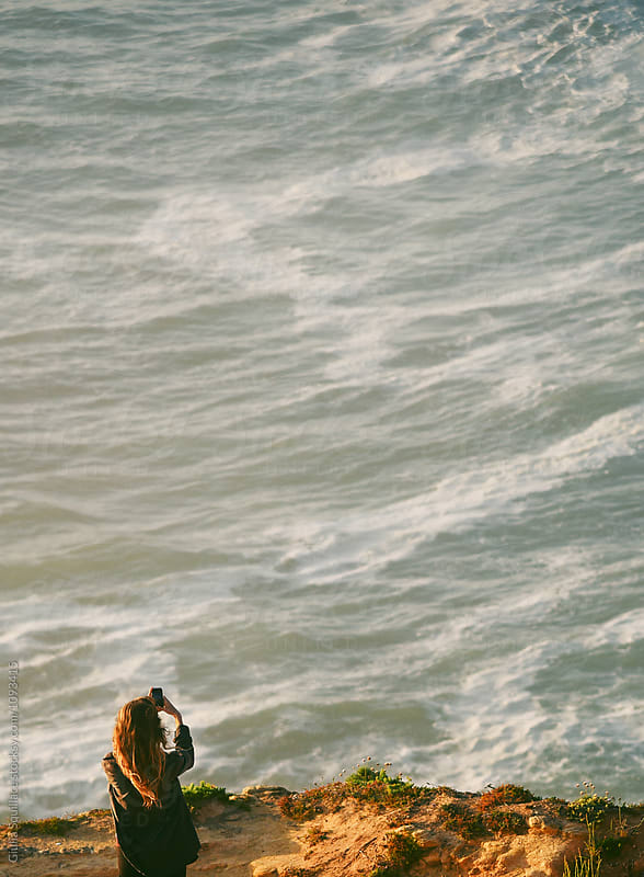 Woman taking pictures of the sea  by Giulia Squillace for Stocksy United