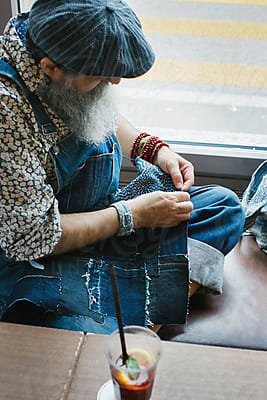 Cool Elderly Male Hipster Relaxing in Stylish Bright