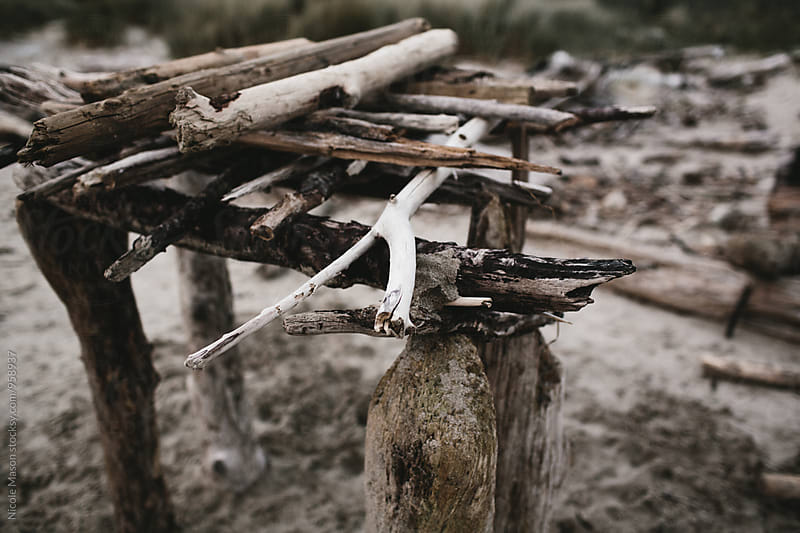 fort made of driftwood on oregon coast by Nicole Mason for Stocksy United